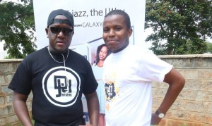 Amos & DJ Joe Mfalme outside K.U Radio Studio